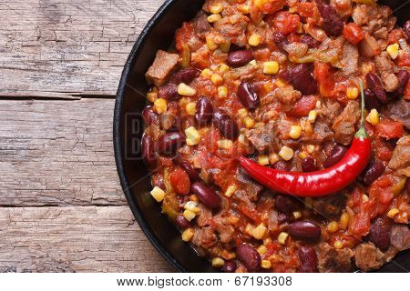 Chili Con Carne Close-up In A Frying Pan Top View