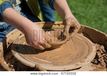 Children Outdoor Studying Using Pottery Wheel