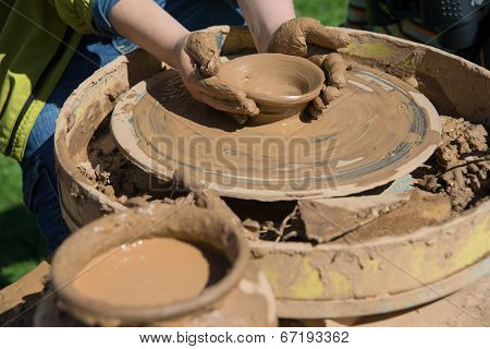 Children Work With Clay Using Pottery Wheel