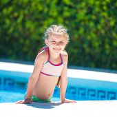 picture of lifeline  - smiling cute little girl swims with a lifeline in the pool - JPG