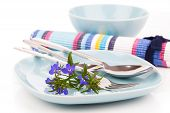 image of lobelia  - tableware with blue lobelia flowers and cutlery on a white background - JPG