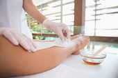 pic of wax  - Woman getting her legs waxed by beauty therapist in the health spa - JPG