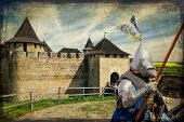 stock photo of armor suit  - Armored knight on warhorse over old medieval castle  - JPG