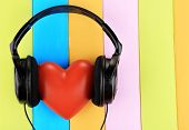 picture of heart sounds  - Headphones and hearts on wooden background - JPG