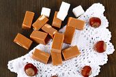 picture of toffee  - Many toffee on napkin on wooden table - JPG