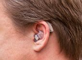 Постер, плакат: ear with ear hearing device