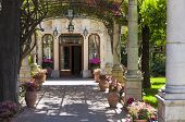 picture of opulence  - Old house enter with flowered trellis from Taormina Italy - JPG