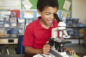 foto of microscope slide  - Boy in science class with microscope - JPG