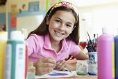 stock photo of pre-teens  - Pre teen girl in art class - JPG
