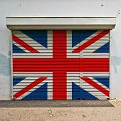 stock photo of roller door  - Great Britain flag on closed shop - JPG