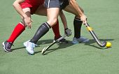 stock photo of up-skirt  - Close up of two field hockey players - JPG