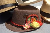 stock photo of panama hat  - A collectrion of fedora and panama hats. One of fedoras with Kuna Ayala panamenian indian crafts.