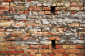 picture of old stone fence  - Abstract background of an obsolete old grunge brick wall - JPG