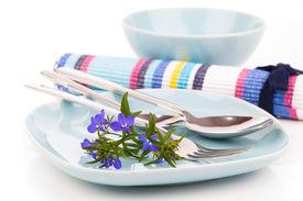 stock photo of lobelia  - tableware with blue lobelia flowers and cutlery on a white background - JPG