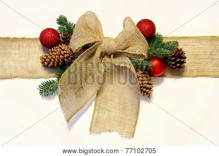 Burlap Christmas Bow, And Ornaments With Pinecones Isolated On White Background