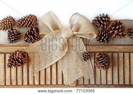 Burlap Christmas Bow And Pinecones Isolated On White Background