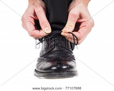 Male Hands Tying Shoelaces