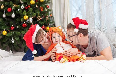Young family with baby boy dressed in fox costume