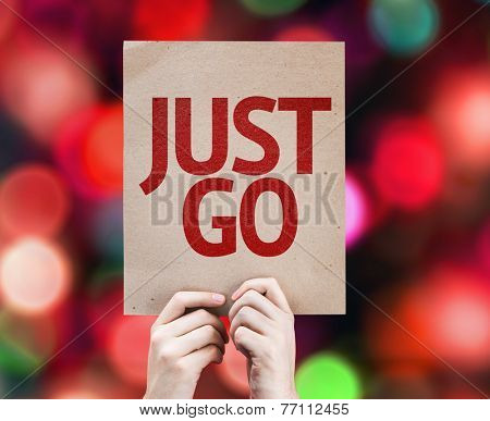 Just Go written on colorful background with defocused lights