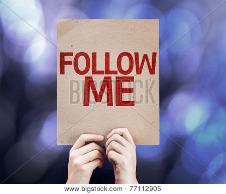 Follow Me written on colorful background with defocused lights