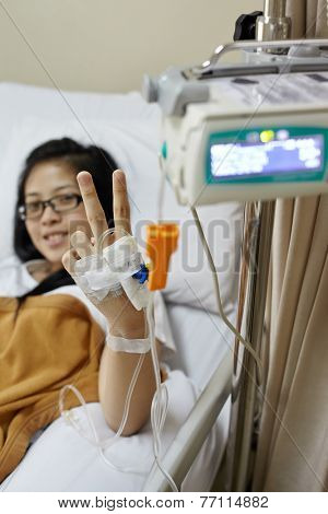 Recover patient smiling and pose to camera. Focus on the hand