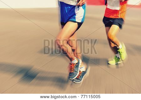 marathon runner legs running on city street