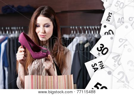 Woman stares at excellent fuchsia shoes at shopping center at a good price