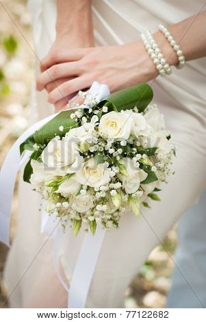 Wedding Bouquet Is In The Hands Of Fiancee
