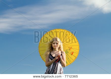 Summer Blonde With Yellow Parasol. Copy Space.