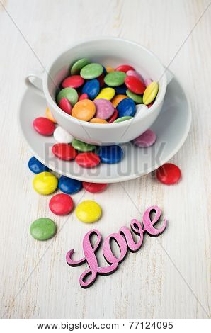 Colorful Candy In A White Cup