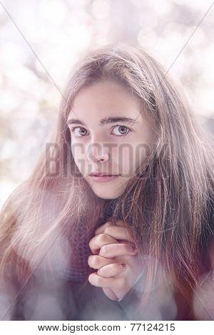 Portrait Of A Beautiful Teenage Girl Praying