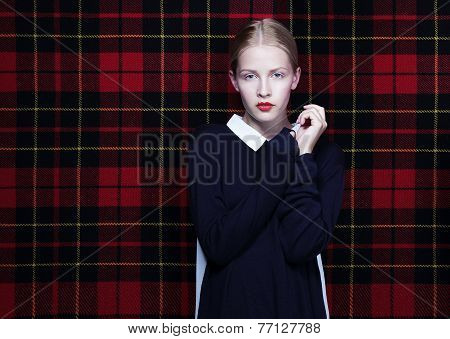 Trendy Young Woman Over Abstract Fabric Background