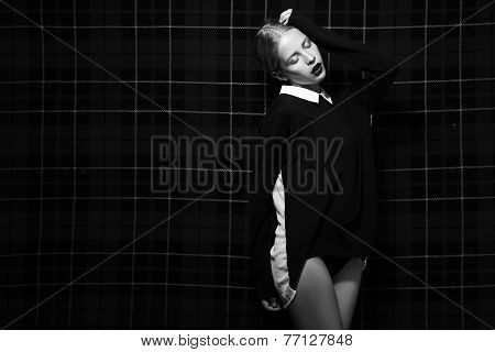 Black And White Image Of Trendy Woman Over Squared Background