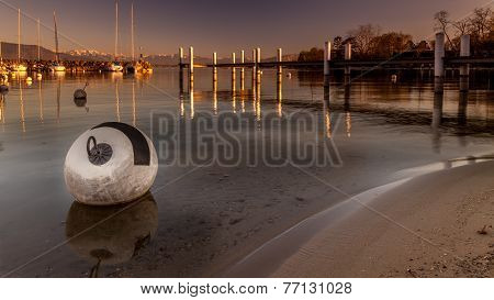 Buoy And Pontoon At Sunset