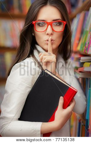 Young Woman Asking for Silence in the Library