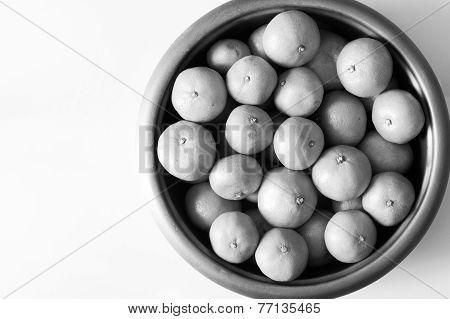 Group of oranges in big bowl