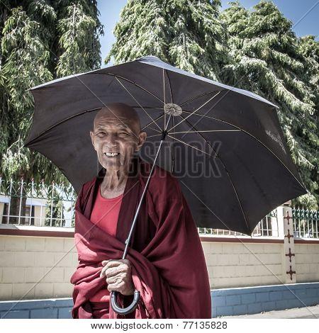 BYLAKUPPE, INDIA - FEB 10, 2013 : Buddhist monk in the Namdroling Monastery in Bylakuppe, Karnataka, India on February 10, 2013. Bylakuppe is one of the biggest Tibetan refugee settlements in India.