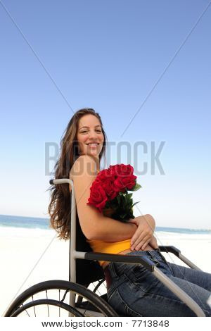 Woman In Wheelchair With Red Roses