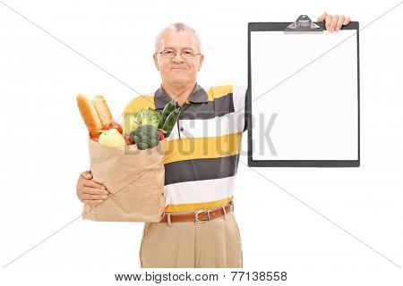 Mature man holding grocery bag and a clipboard isolated on white background