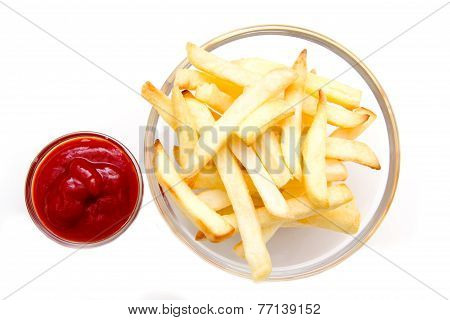 Bowl of chips and ketchup from above