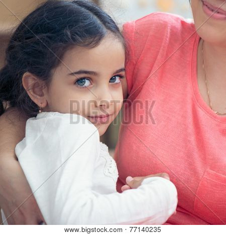 Portrait Of Lovely Hispanic Mother And Daughter