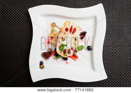 Asian fruit dessert with lotus root and berries shot from above