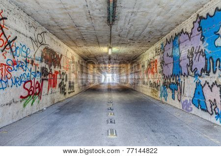Narrow Tunnel With Graffiti
