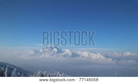 Misty snow-capped Mountain on a clear winter's day