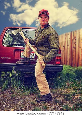 a redneck man with an axe in his hands toned with a retro vintage instagram filter effect