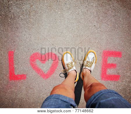 two feet making a sign for the letter V in the word love