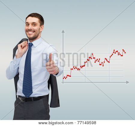 business, people, success and finances concept - smiling young businessman showing thumbs up gesture over gray background and forex graph going up