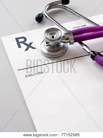 Closeup of a stethoscope on a rx prescription.