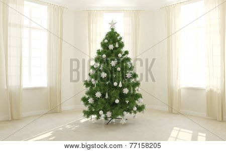 Christmas tree in a light room with windows