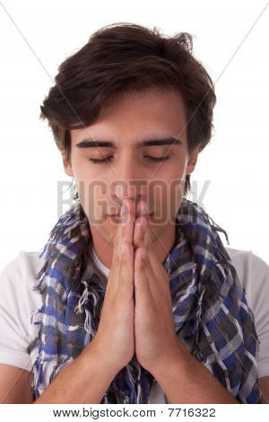Praying Young Man, Isolated On White Background. Studio Shot.
